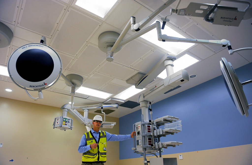 . Bill Gregor, Director of Operations for Mortenson Construction, talks about medical equipment in one of the new operating rooms at Exempla Saint Joseph Hospital, which has been under construction since July, 2011, and will receive its first patient in the new facility mid-December of this year.Photo by Jamie Cotten, Special to The Denver Post