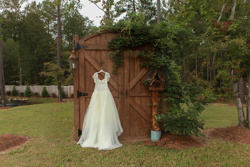 Bryce and Marissa prepare at the Simply Southern Barn Wedding Venue in Milledgeville, Georgia.
