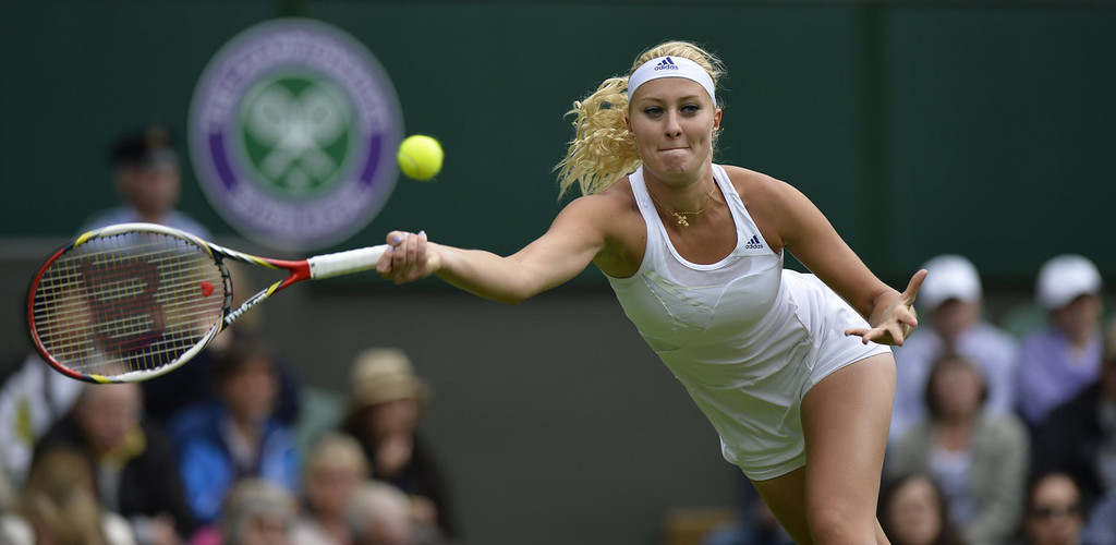 . France\'s Kristina Mladenovic returns against Russia\'s Maria Sharapova during their women\'s first round match on day one of the 2013 Wimbledon Championships tennis tournament at the All England Club in Wimbledon, southwest London, on June 24, 2013. Sharapova won 7-6, 6-3.  ADRIAN DENNIS/AFP/Getty Images