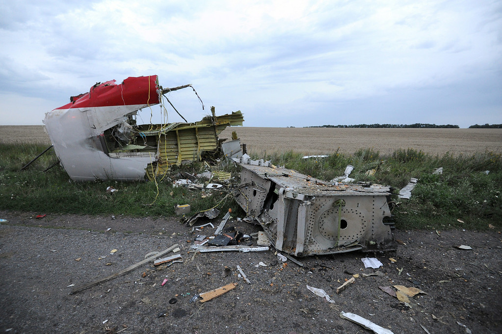 . A picture taken on July 17, 2014 shows the wreckages of the malaysian airliner carrying 295 people from Amsterdam to Kuala Lumpur after it crashed, near the town of Shaktarsk, in rebel-held east Ukraine. Pro-Russian rebels fighting central Kiev authorities claimed on Thursday that the Malaysian airline that crashed in Ukraine had been shot down by a Ukrainian jet. The head of Ukraine\'s air traffic control agency said Thursday that the crew of the Malaysia Airlines jet that crashed in the separatist east had reported no problems during flight. AFP PHOTO/DOMINIQUE  FAGET/AFP/Getty Images