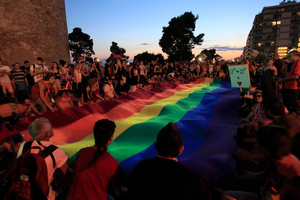 . Gay activists hold a giant rainbow flag during a  parade in Thessaloniki, Saturday, June 15, 2013.   (AP Photo/Nikolas Giakoumidis)