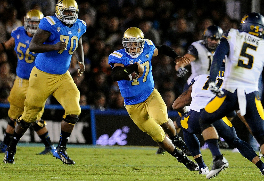 . UCLA quarterback Brett Hundley (17) scrambles against California during the first half of their college football game in the Rose Bowl in Pasadena, Calif., on Saturday, Oct. 12, 2013.   (Keith Birmingham Pasadena Star-News)