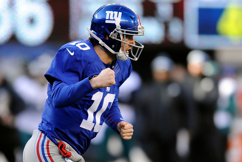 . New York Giants quarterback Eli Manning (10) reacts after throwing a toucdown pass to Rueben Randle during the first half of an NFL football game against the Philadelphia Eagles, Sunday, Dec. 30, 2012, in East Rutherford, N.J. (AP Photo/Bill Kostroun)
