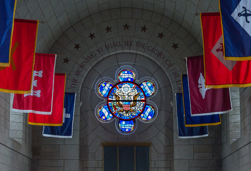 Inside Memorial Chapel, front.  Window design based on the Great Seal of the United States.
