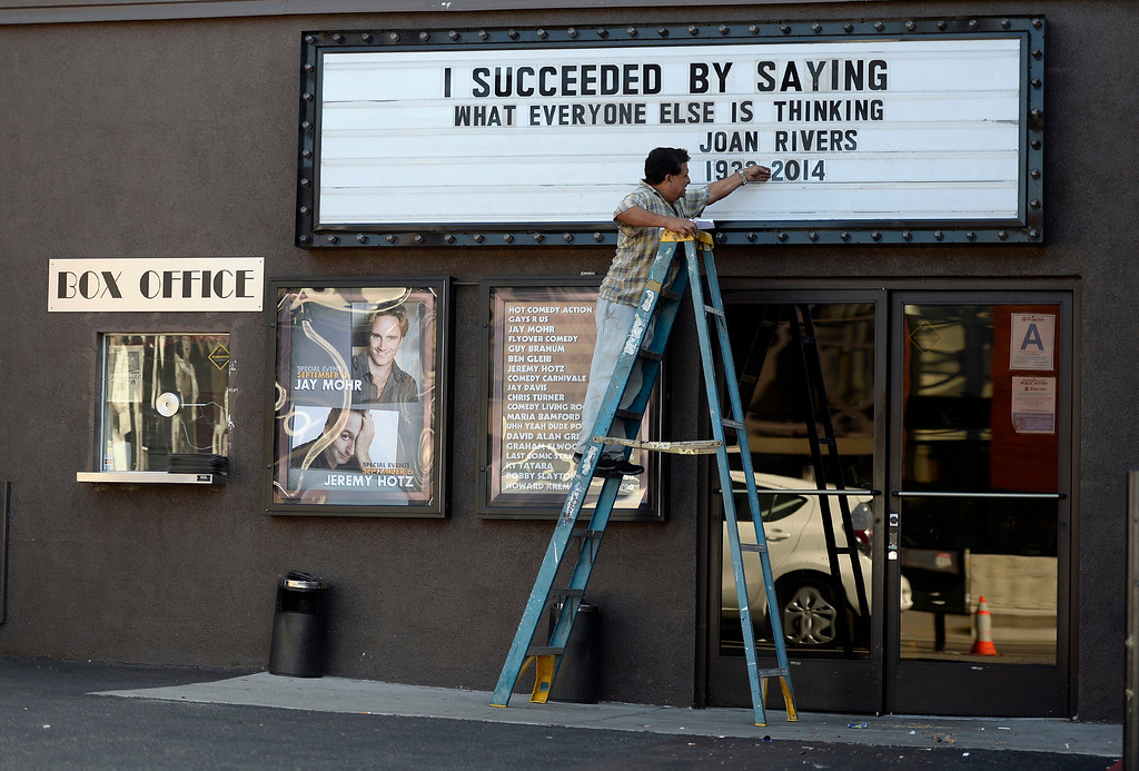 . A worker changes the marquee of the Improv comedy club to display a quote from the late comedian Joan Rivers on September 4, 2014 in Los Angeles, California. Rivers died today in Manhattan. (Photo by Kevork Djansezian/Getty Images)