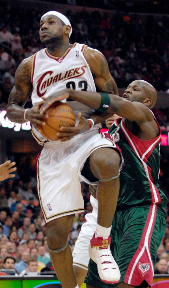 Description of . Cavaliers forward Lebron James is blocked from making a basket by Bucks forward Ruben Patterson in the first quarter Wednesday in Cleveland.