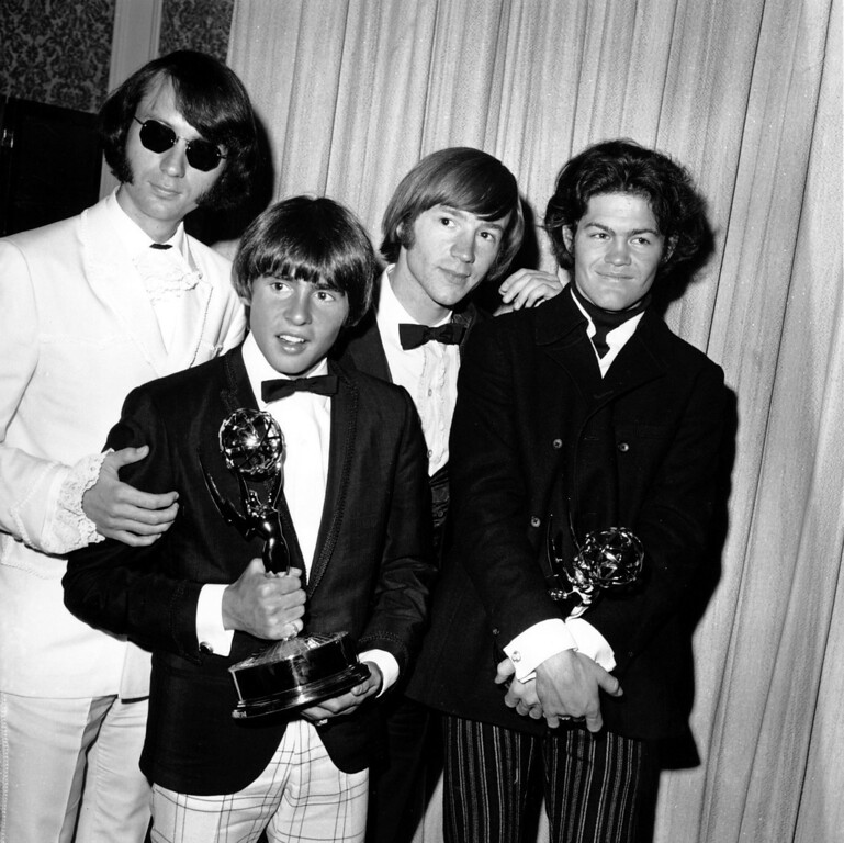 """. The Monkees pose with their Emmy award at the 19th Annual Primetime Emmy Awards in Calif. on June 4, 1967.  They won for best comedy series and best comedy direction for their television program \""""The Monkees.\""""  The group members are, from left to right, Mike Nesmith, Davy Jones, Peter Tork, and Micky Dolenz.  (AP Photo)"""