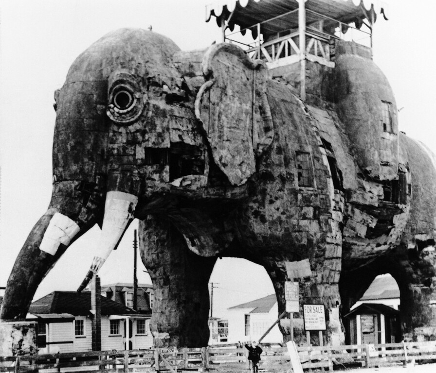 . Lucy, the 88-year-old elephant who is a city landmark, will be restored and converted into a children\'s library, if Margate residents get their way in Margate, New Jersey on Jan. 23, 1970. The Save Lucy Committee is in the throes of a campaign to raise money to move Lucy onto city property from the privately-owned site which is up for sale, and then beautify her. Lucy dwarfs admirer Stacey Kroger, 5. (AP Photo)