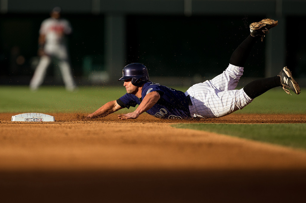 . Michael McKenry #8 of the Colorado Rockies steals second base during the second inning against the Atlanta Braves at Coors Field on June 9, 2014 in Denver, Colorado.  (Photo by Justin Edmonds/Getty Images)