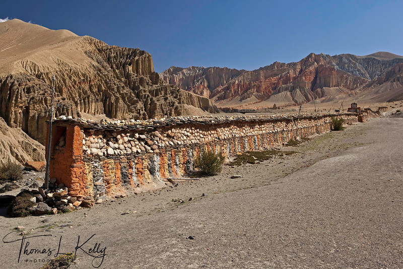 Longest Mani wall in Mustang with view of Dhakmar cliff on the background. Mustang, Nepal.