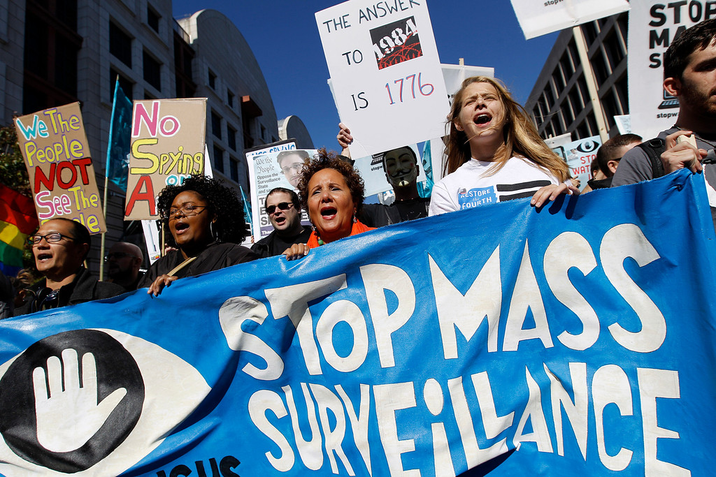 . Demonstrators march through Washington towards the National Mall in Washington to demand that Congress investigate the National Security Agency\'s mass surveillance programs Saturday, Oct. 26, 2013. ( AP Photo/Jose Luis Magana)