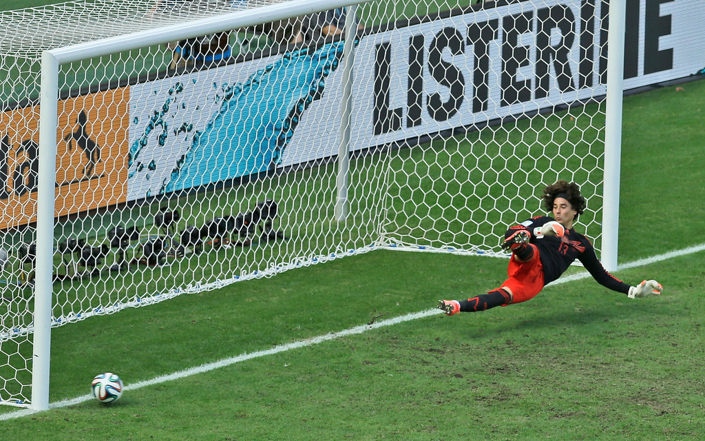 . Mexico\'s goalkeeper Guillermo Ochoa fails to save a shot by Netherlands\' Klaas-Jan Huntelaar from the penalty spot during the World Cup round of 16 soccer match between the Netherlands and Mexico at the Arena Castelao in Fortaleza, Brazil, Sunday, June 29, 2014. Holland won 2-1 and advanced to the quarterfinal.  (AP Photo/Themba Hadebe)