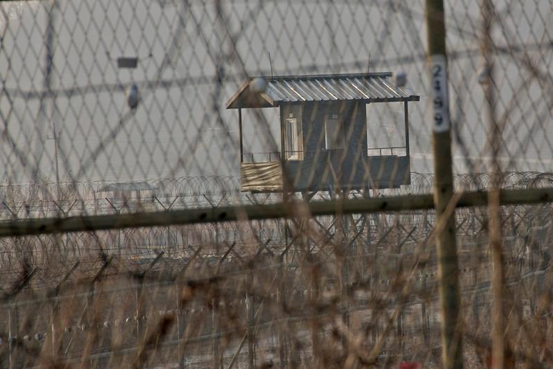 Shot of the guard tower through barb wire - DMZ, South Korea