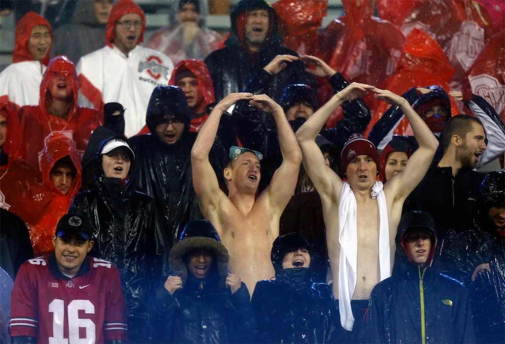 . Ohio State fans cheer in the rain as time runs out during an NCAA college football game against Saturday, Nov. 18, 2017, in Columbus, Ohio. (AP Photo/Jay LaPrete)