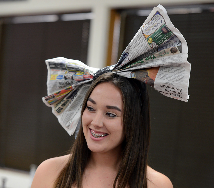 . To top off her outfit, Lacey Lopez sports a recycled newspaper bow to model with her high low skirt at the third annual Paper Skirt Fashion Show held at Liberty High School in Brentwood, Calif.  on Tuesday, Jan. 29, 2013.  (Susan Tripp Pollard/Staff)