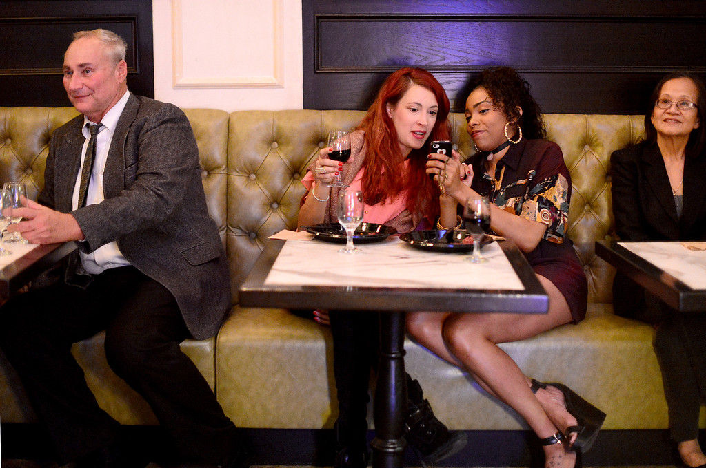". From left, travel agent Joe Wager, travel and fashion writers Jackie Chambers and Bella Graham and travel agent See Kean attend ""Taste Taiwan\"" event at Trattoria Neapolis in Pasadena Tuesday night, January 14, 2014. Trattoria Neapolis\' chef Bryant Wigger, one of three chefs chosen in North America for the show \""Taste Taiwan,\"" shares his culinary adventure on the island and a fusion pork dish recipe he came up with which he plans to include at the Pasadena restaurant.  (Photo by Sarah Reingewirtz/Pasadena Star-News)"