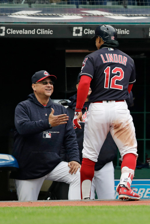 . Cleveland Indians\' Francisco Lindor, right, is congratulated by manager Terry Francona after Lindor hit a solo home run in the seventh inning of a baseball game, Saturday, May 12, 2018, in Cleveland. The Indians won 6-2. (AP Photo/Tony Dejak)
