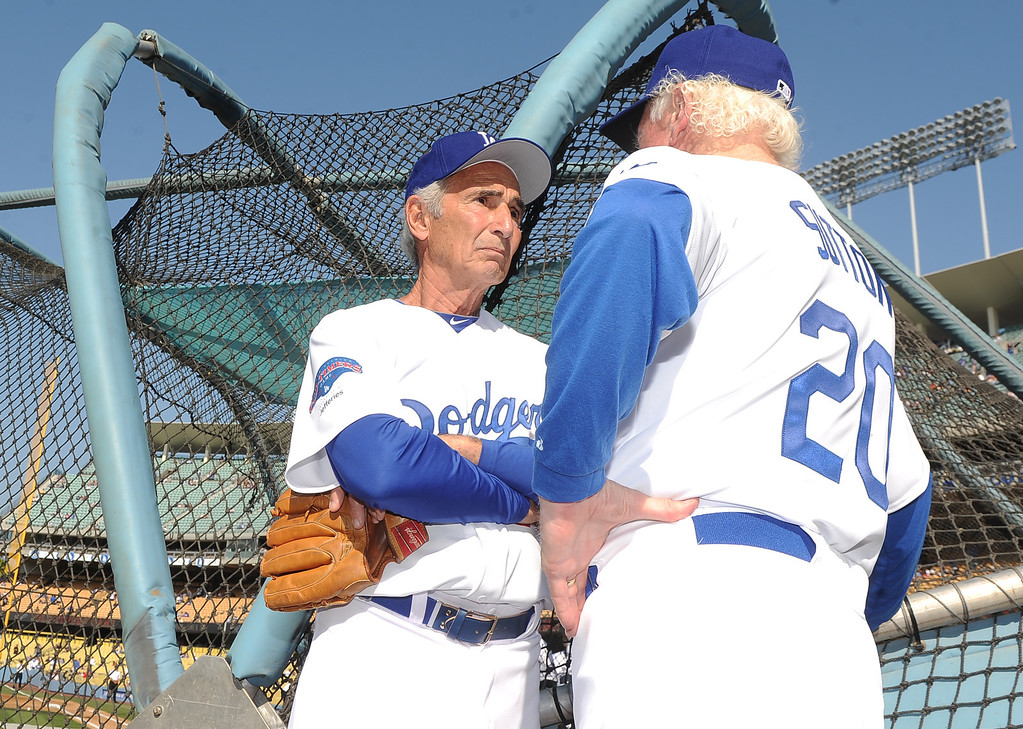. Hall of famer and former Los Angeles and Brooklyn Dodger left handed pitcher Sandy Koufax, left, talks with hall of famer and former Los Angeles Dodgers right hander, Don Sutton during the Old-Timers game prior to a baseball game between the Atlanta Braves and the Los Angeles Dodgers on Saturday, June 8, 2013 in Los Angeles. 
