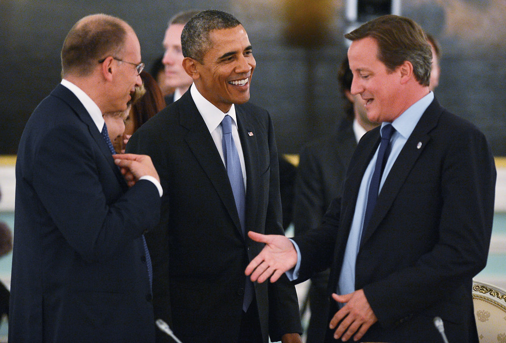 . In this handout image provided by Host Photo Agency, (L to R) Italian Prime Minister Enrico Letta, U.S. President Barack Obama and British Prime Minister David Cameron talk during a working dinner for G20 Summit members September 5, 2013 in St. Petersburg, Russia.  (Photo by Ramil Sitdikov/Host Photo Agency via Getty Images)