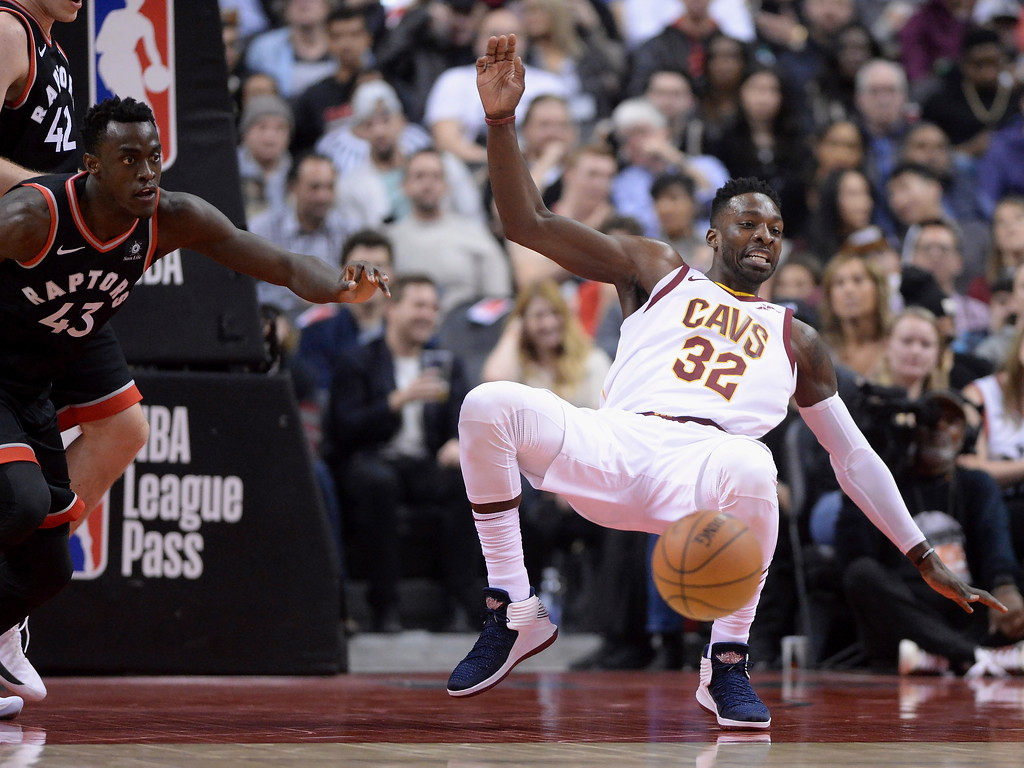 . Cleveland Cavaliers forward Jeff Green (32) falls as Toronto Raptors forward Pascal Siakam (43) goes for a loose ball during the first half of an NBA basketball game Thursday, Jan. 11, 2018, in Toronto. (Frank Gunn/The Canadian Press via AP)