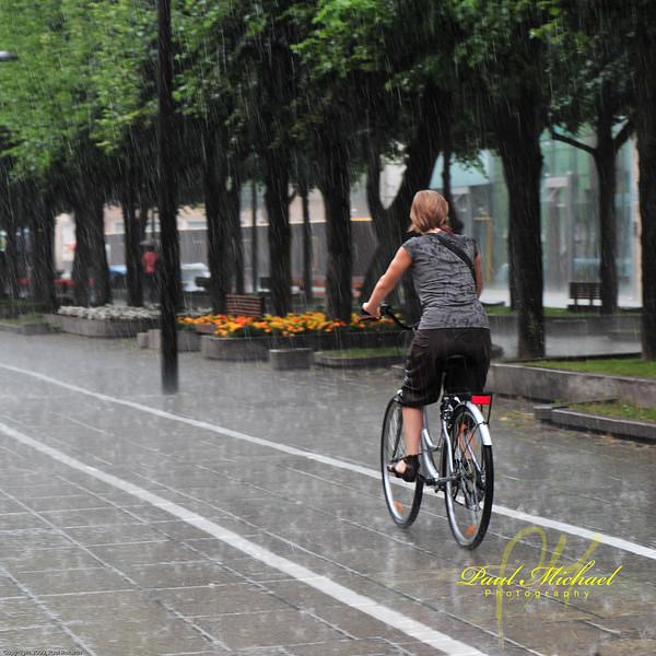 Biking in the rain on Freedom Avenue.