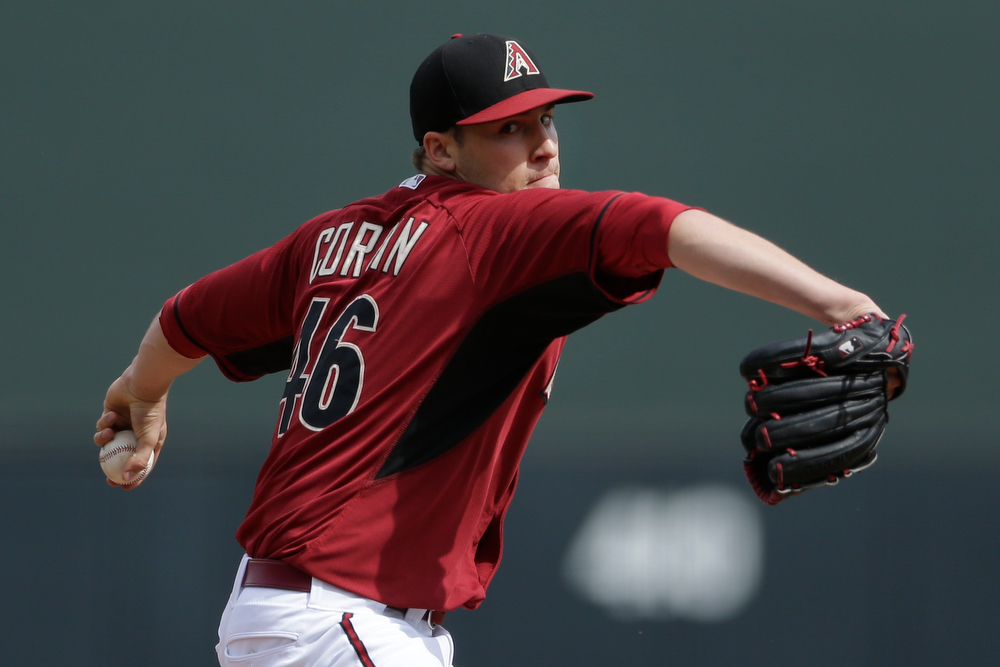 . Arizona Diamondbacks starting pitcher Patrick Corbin throws against the Colorado Rockies during the first inning in a spring training baseball game on Friday, Feb. 28, 2014, in Scottsdale, Ariz. (AP Photo/Gregory Bull)