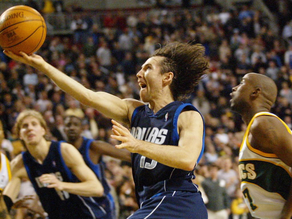 . Dallas Mavericks\' Steve Nash of Canada drives to the basket in the final seconds of the game against the Seattle SuperSonics in Seattle, Sunday, Jan. 19, 2003.  (AP Photo/John Froschauer)