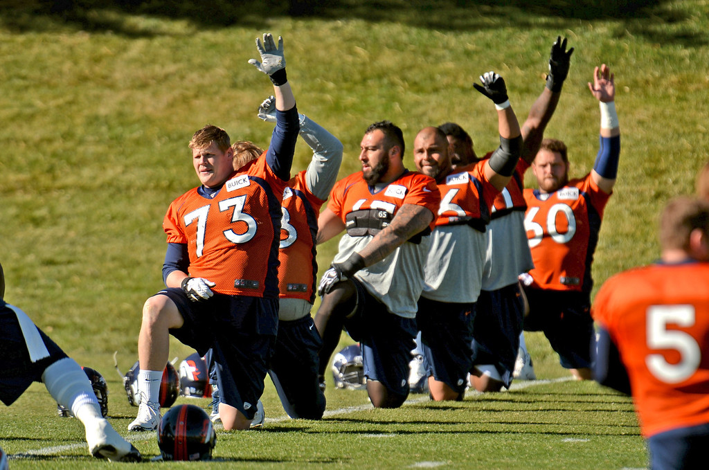 . Denver Broncos Chris Kuper (73) and offensive line are warming up for the team practice at Dove Valley practice field, Englewood, Colorado. November 15, 2013. (Photo by Hyoung Chang/The Denver Post)
