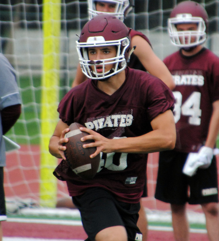 . Jon Behm - The Morning Journal<br> Scenes from Rocky River\'s first day of football practice on July 30.
