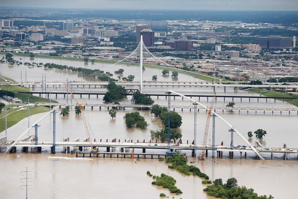. A swollen Trinity river is seen in an aerial photo just west of downtown Dallas, Friday, May 29, 2015. Floodwaters submerged Texas highways and threatened more homes Friday after another round of heavy rain added to the damage inflicted by storms. (AP Photo/Brandon Wade)