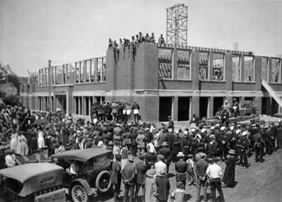 This photograph from the Spearfish Area Historical Society captures what has been described as the laying of the cornerstone for the new high school building in Spearfish.  No date is on the photo, but the specific date should be easily determined.   A note on the back of the photograph says members of the school board are standing beside the corner of the building facing the crowd.
