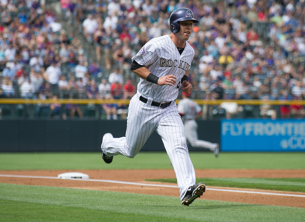 . Corey Dickerson #6 of the Colorado Rockies scores a run in the first inning of a game against the Cincinnati Reds at Coors Field on September 1, 2013 in Denver, Colorado. (Photo by Dustin Bradford/Getty Images)