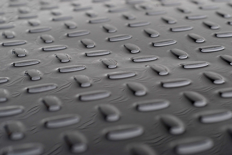 2011/5/19 – I love abstracts and repetitive patterns. This is the top of my truck box in the back of my truck. We've had days of continuous rain so the top has standing water that is reflecting the siding on our home. That's what creates the funny pattern between the nubby texture.