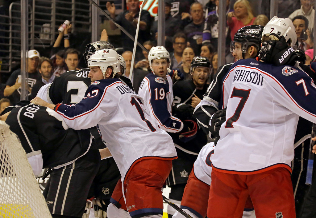 . A melee erupts between the Columbus Blue Jackets and the Los Angeles Kings after the final horn in an NHL hockey game in Los Angeles Thursday, April 18, 2013. The Kings won, 2-1. (AP Photo/Reed Saxon)