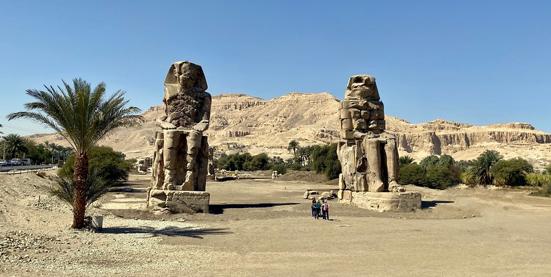 The Colossi of Memnon represent Amenhotep III (1386-1353 BC) They were constructed as guardians for his mortuary complex which once stood behind them.