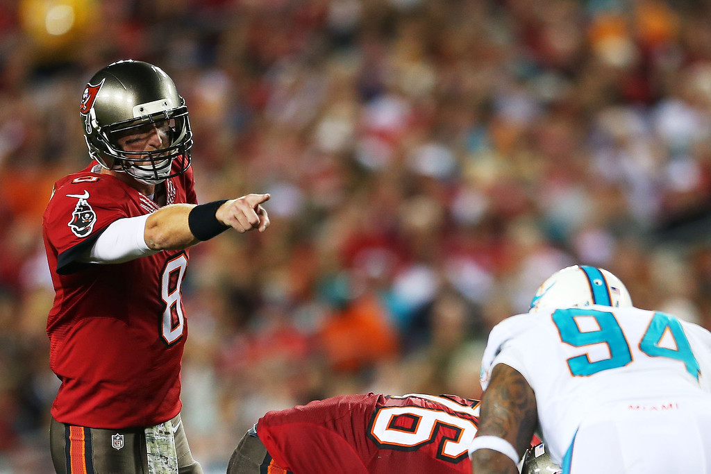 . TAMPA, FL - NOVEMBER 11:   Mike Glennon #8 of the Tampa Bay Buccaneers calls a play in the first half against the Miami Dolphins at Raymond James Stadium on November 11, 2013 in Tampa, Florida.  (Photo by Mike Ehrmann/Getty Images)