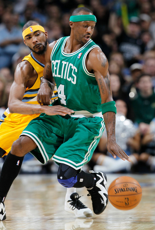. Denver Nuggets forward Corey Brewer, left, tries to knock ball away from Boston Celtics guard Jason Terry in the fourth quarter of the Nuggets\' 97-90 victory in an NBA basketball game in Denver on Tuesday, Feb. 19, 2013. (AP Photo/David Zalubowski)