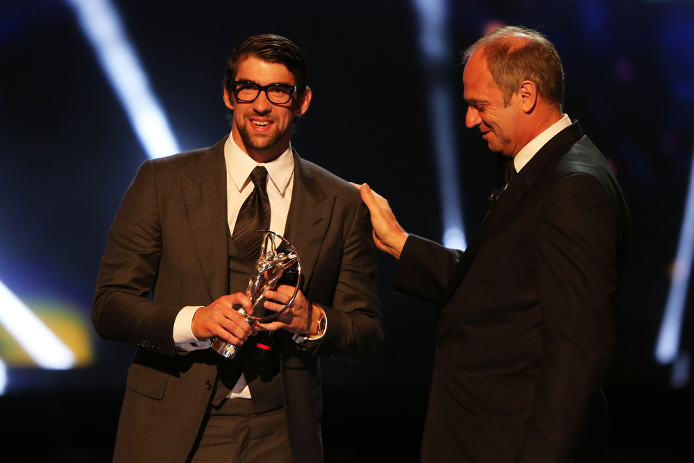 . Michael Phelps receives his  Laureus Academy Exceptional Acheivement Award from Laureus Academy Member Sir Steve Redgrave during the awards show for the 2013 Laureus World Sports Awards at the Theatro Municipal Do Rio de Janeiro on March 11, 2013 in Rio de Janeiro, Brazil.  (Photo by Ian Walton/Getty Images For Laureus)