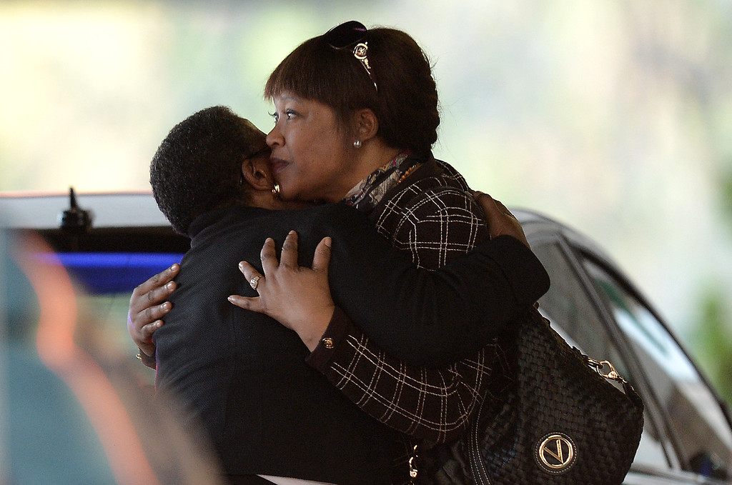 . Nelson Mandela\'s daughter, Zindzi Mandela (R) is hugged by an unidentified person as she arrives at the Medi Clinic Heart hospital in Pretoria on June 26, 2013, where former South Africa\'s president Nelson Mandela lays in critical condition.  FILIPPO MONTEFORTE/AFP/Getty Images