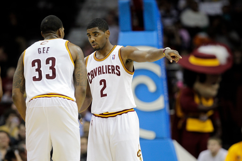 . Cleveland Cavaliers\' Kyrie Irving (2) talks to Alonzo Gee (33) during a preseason NBA basketball game against the Detroit Pistons Tuesday, Dec. 20, 2011, in Cleveland. (AP Photo/Mark Duncan)