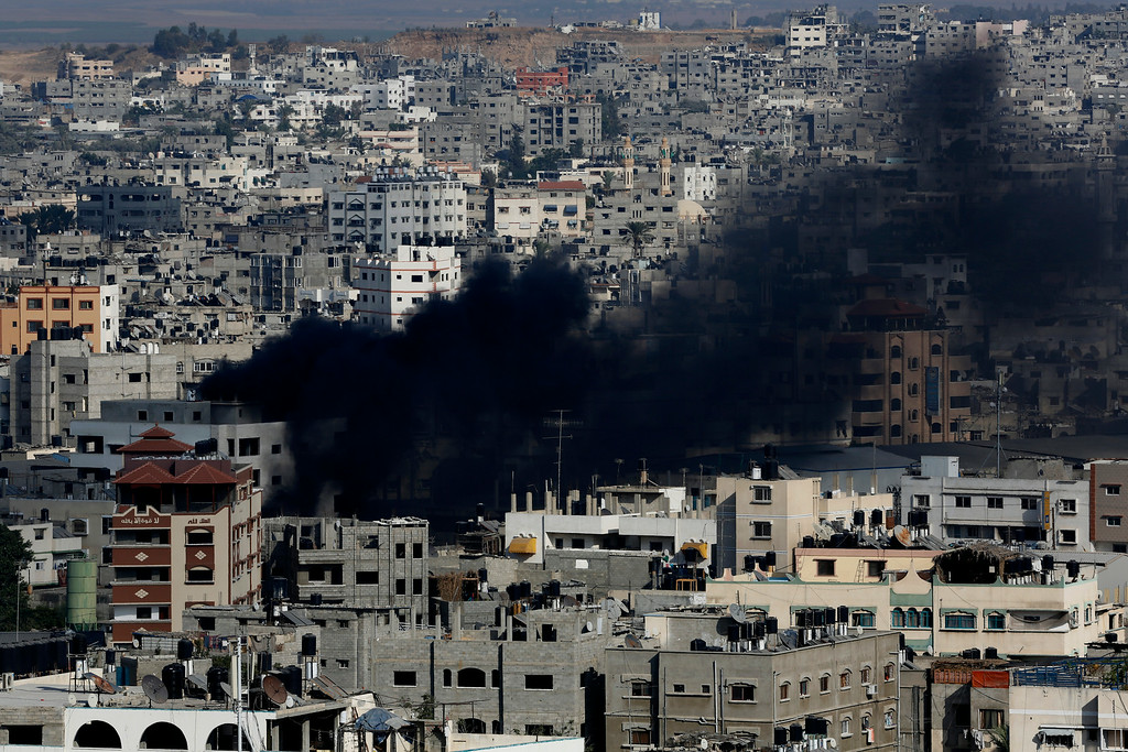 . Black smoke rises after an Israeli strike hits Gaza City in the northern Gaza Strip, Saturday, Aug. 23, 2014. (AP Photo/Adel Hana)