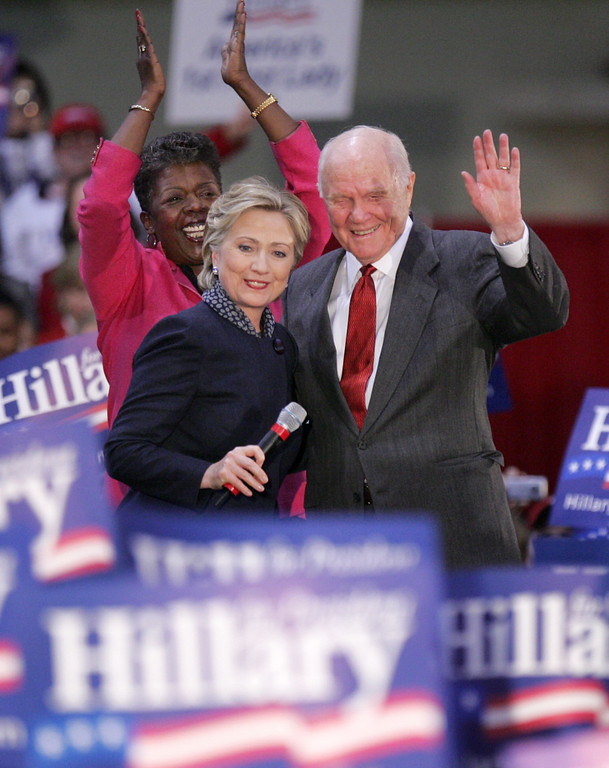 . Former Ohio Sen. John Glenn, right, introduces Democratic presidential hopeful, Sen. Hillary Rodham Clinton, D-N.Y.,center, as Rep. Stephanie Tubbs Jones, D-Ohio, applauds at left, Thursday, Feb. 14, 2008, during a rally at The Ohio State University in Columbus, Ohio. (AP Photo/Paul Vernon)