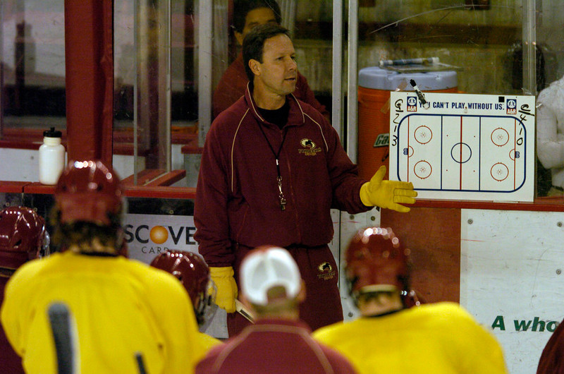 . Coach George Gwozdecky of the Denver Pioneers runs through a drill during practice. (DENVER POST PHOTO BY JOHN LEYBA)