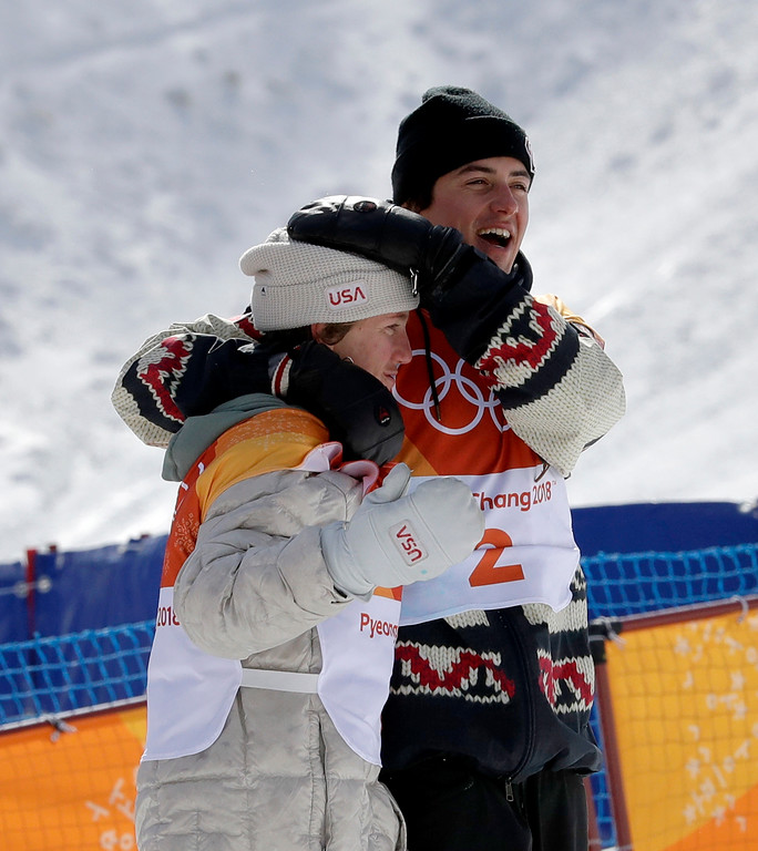 . Gold medal winner Red Gerard, of the United States, left, and bronze medal winner Mark McMorris, of Canada, embrace after the men\'s slopestyle final at Phoenix Snow Park at the 2018 Winter Olympics in Pyeongchang, South Korea, Sunday, Feb. 11, 2018. (AP Photo/Lee Jin-man)