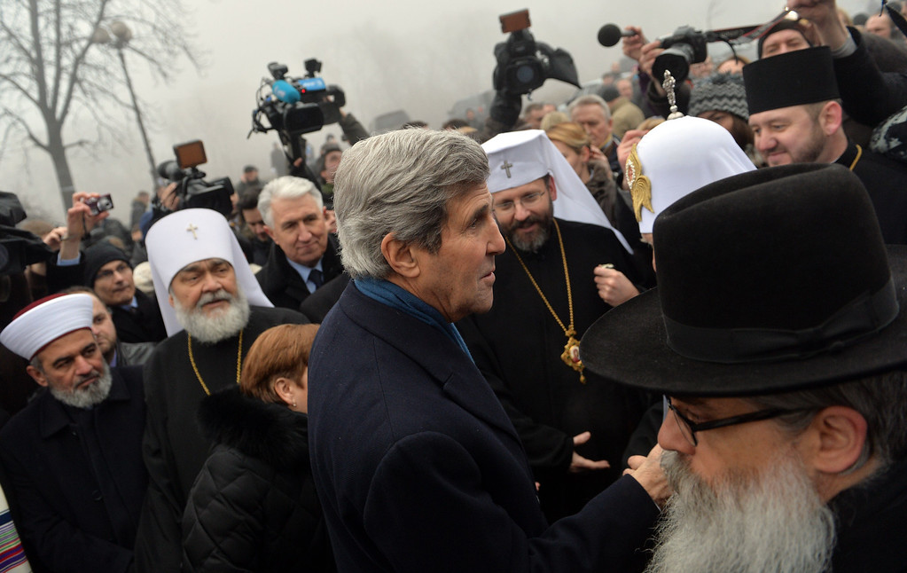 . US Secretary of State John Kerry speaks to heads of the religious confession at the Shrine of the Fallen of anti-government protesters in Kiev on March 4, 2014. Kerry arrived in Kiev for talks with Ukraine\'s new interim government, amid an escalating crisis in Crimea. AFP PHOTO/ SERGEI SUPINSKY/AFP/Getty Images