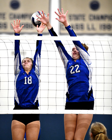 11/1/2019 Mike Orazzi | StaffrBristol Eastern's Leah Chipman (18) and Hannah Webber (22) during Friday night's girls volleyball match with Lyman Memorial in Bristol.