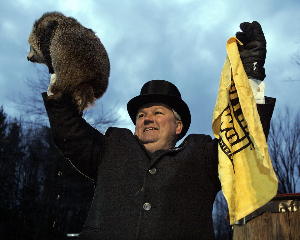 ". Punxsutawney Phil, the weather predicting groundhog, is held up by his handler Bill Deeley while holding a ""Terrible Towel\"" after the prediction of six more weeks of winter was announced in Punxsutawney, Pa. on Thursday, Feb. 2, 2006. The towel is used by Pittsburgh Steelers fans to show support for their team who are playing in the Super Bowl on Sunday, Feb. 5. (AP Photo/Keith Srakocic)"
