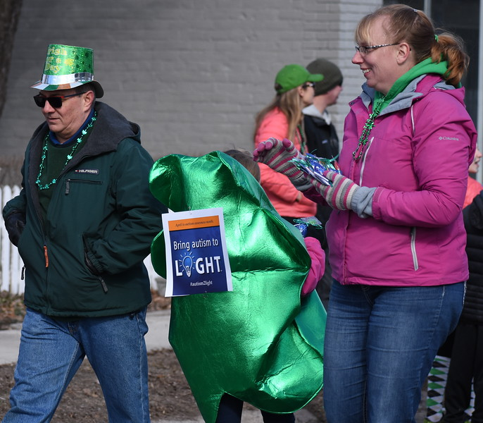Dressed in their best green looks, spectators watch the annual St. Patrick's Day Parade in Royal Oak, Michigan on March 10, 2018. (Photo by Brandy Baker)