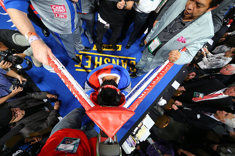 . Manny Pacquiao prays in the ring before taking on Juan Manuel Marquez during their welterweight bout at the MGM Grand Garden Arena on December 8, 2012 in Las Vegas, Nevada.  (Photo by Al Bello/Getty Images)