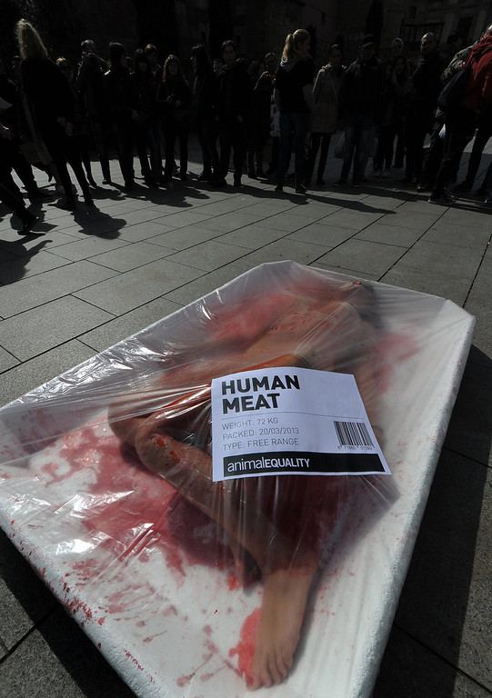 ". An activist from the animal rights group ""Animal Equality\"" poses in a giant meat packaging tray at the Cathedral square in Barcelona on March 20, 2013 during an event to mark global meat-free day.  LLUIS GENE/AFP/Getty Images"
